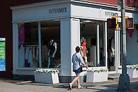 Upscale retail stores and businesses, including Intermix, on  Bleecker Street in Greenwich Village in New York on Friday, June 29, 2012. (© Richard B. Levine)