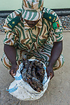Anti-poaching commander with confiscated bushmeat from poacher, Kafue National Park, Zambia