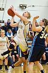 02/08/13--Milwaukie Mustangs senior Alexis Noren (2) shoots a lay-in over Liberty Falcons' Emily Flinn (34) in the first half at Milwaukie High School..Photo by Jaime Valdez.