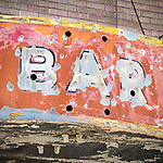 Ruins of now-abandoned brick building with weathered bar and cafe neon signs, all soon to be demolished, Carlin, Nevada