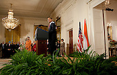 Washington, DC - November 24, 2009 -- United States President Barack Obama speaks during a ceremony with Manmohan Singh, India's prime minister, in the East Room of the White House in Washington, D.C., U.S., on Tuesday, November 24, 2009. Singh was welcomed to the White House this morning by Obama for a state visit where the two leaders will have discussions on curbing nuclear weapons, climate change and trade. .Credit: Andrew Harrer - Pool via CNP