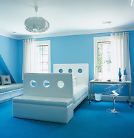 "The modern blue and white bedroom has a bespoke ""see-through"" bed by Alison Spear and Ero/S/ desk chair"