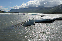 In early summer river ice known as aufeis can still be found along the Hulahula River as it flows north from Alaska's Brooks Range mountains to the Coastal Plain in the Arctic National Wildlife Refuge.