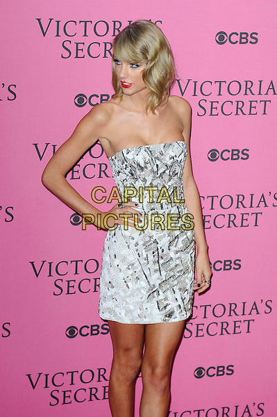 LONDON, ENGLAND - DECEMBER 2: Taylor Swift attends the pink carpet for Victoria's Secret Fashion Show 2014, Earls Court on December 2, 2014 in London, England.<br /> CAP/MAR<br /> &copy; Martin Harris/Capital Pictures