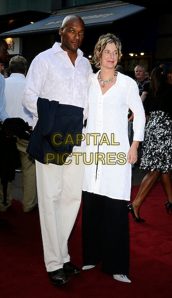 "COLIN SALMON & FIONA HAWTHORNE.UK Film Premiere of ""Cass"" held at the Empire cinema , Leicester Square, London, England. .July 28th 2008.full length married husband wife white shirt trousers top kaftan cream beige black.CAP/CAN.©Can Nguyen/Capital Pictures."