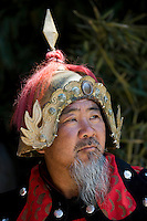 Man dressed in Mongolian Warrior costume at The Great Wall of China, Mutianyu, north of Beijing (formerly Peking)