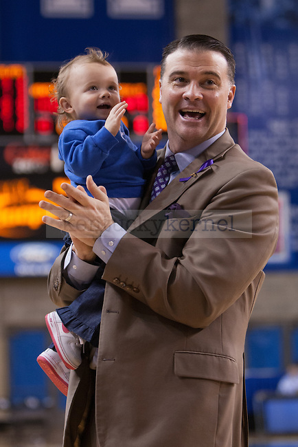UK women's basketball head coach Matthew Mitchell and his daugter Sailor Rose  at the conclusion of the UK vs. Mississippi basketball game at Memorial Coliseum on Tuesday, Jan. 17, 2013. Photo by Adam Chaffins | Staff