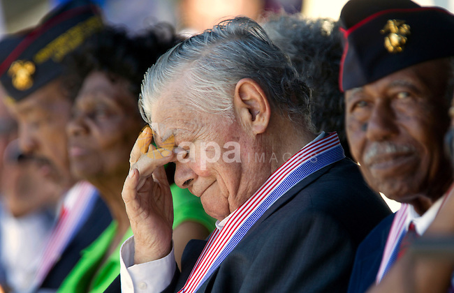 Aug. 14, 2012 - Camp Pendleton, California, U.S. - TONY LLORENS JR., 88, from Los Angeles, wipes tears from his eyes after he and eight other Montford Point Marines received a Congressional Gold Medal during a commemorative ceremony honoring the African American men who joined the Marines in the 1940's and trained at the segregated training facility in North Carolina at Camp Pendleton on Tuesday. (Credit Image: © Hayne Palmour/North County Times/ZUMAPRESS.com)