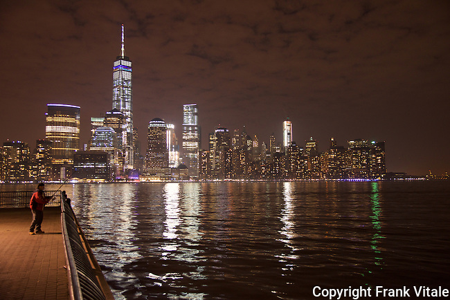 Night Fisherman Against Backdrop of Freedom Tower and Lower Manhattan