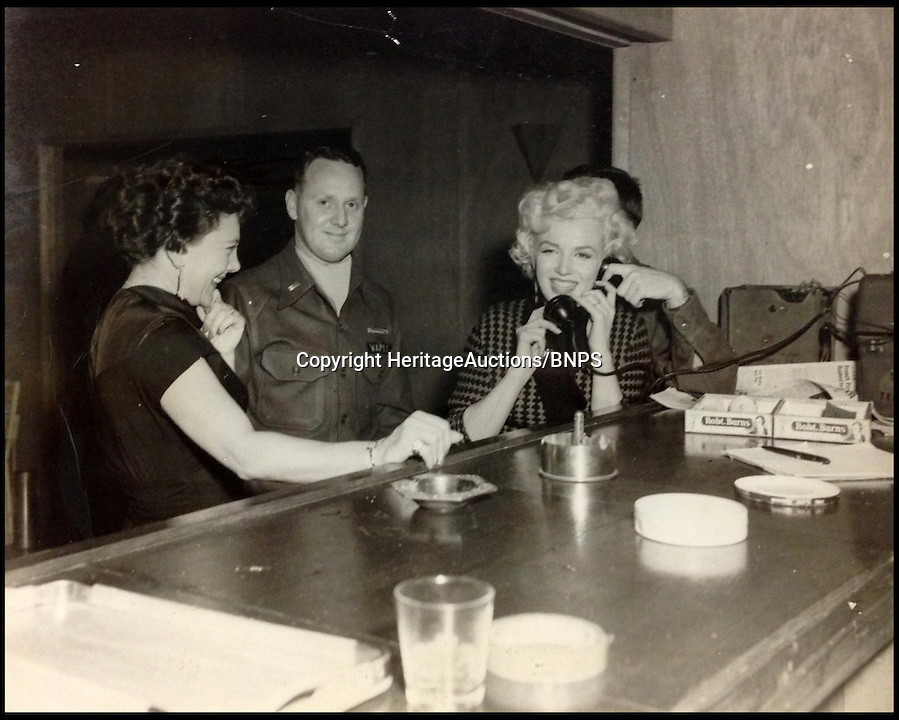 BNPS.co.uk (01202) 558833<br /> Picture: HeritageAuctions<br /> <br /> **please use full bylline**<br /> <br /> Never-seen-before photos and footage of Marilyn Monroe wooing soldiers in the aftermath of the Korean War have emerged for sale. The whirlwind tour saw the star perform 10 shows over four days to more than 100,000 soldiers and marines who were celebrating the end of three years of combat in 1954. The rare images were bought by a collector in the 1990s direct from the military photographer and have never been published.