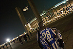 Two home fans standing outside the stadium before Hertha Berlin's match against  Sporting Lisbon at the Olympic Stadium in Berlin in the group stages of the UEFA Europa League. Hertha won the match by 1 goal to nil to press to the knock-out round of the cup. 2009/10 was the the first year in which the Europa League replaced the UEFA Cup in European football competition.
