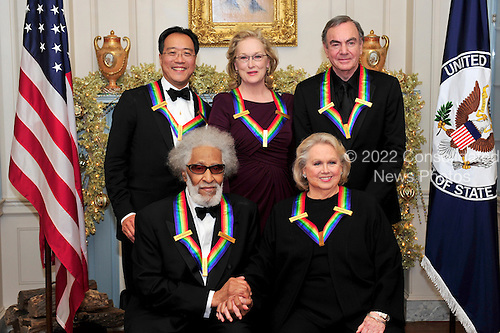 The five recipients of the 2011 Kennedy Center Honors pose for a photo following a dinner hosted by United States Secretary of State Hillary Rodham Clinton at the U.S. Department of State in Washington, D.C. on Saturday, December 3, 2011. Back row, from left to right: musician Yo-Yo Ma; actress Meryl Streep; and singer Neil Diamond. Front row, from left to right: musician Sonny Rollins; and actress Barbara Cook..Credit: Ron Sachs / CNP