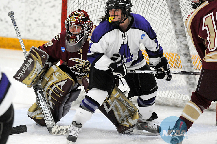 20 Mar 2010:  Goalie Cindy Fortin (30) of Norwich University watches the puck along with Michelle McGann of Amherst College (11) during the Division III Women's Ice Hockey Championship game held at the Don Roberts Ice Rink on the Gustavus Adolphus College campus in St. Peter, MN. Amherst defeated Norwich 7-2. Vince Muzik/NCAA Photos