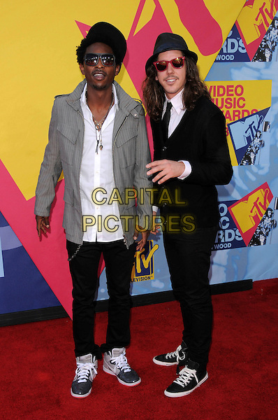 SHWAYZE & CISCO ADLER .The 2008 MTV Video Music Awards held at Paramount Studios in Hollywood, California, USA..September 7th, 2008.full length grey gray jacket black white shirt sunglasses shades hat VMA Vmas.CAP/DVS.©Debbie VanStory/Capital Pictures.