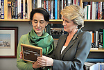 AUSTRALIA, Sydney : Myanmar opposition leader Aung San Suu Kyi speaks with Australian Foreign Minister Julie Bishop at Parliament House Canberra on November 28, 2013. Suu Kyi is on a five-day trip to Australia, visiting Sydney, Canberra and Melbourne. AFP PHOTO / Mark GRAHAM