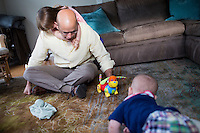 Fred Bermont plays with daughter Elyse Bermont (age 2.5) and son Dylan Bermont (age 9 months) in their home in Lexington, Massachusetts, USA, before he goes to work and drops the kids off at day-care on June 9, 2014. Bermont is the father of two children and shares parenting duties with his wife, Jen Bermont. Fred usually takes care of the morning routine, including feeding, dressing, and dropping the kids off at day-care, and Jen picks them up and watches over them in the afternoon. Fred is a Senior Clinical Standards Specialist at Shire, a pharmaceutical company with headquarters in Lexington.