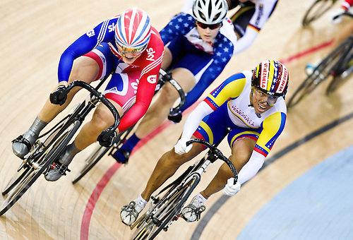 19 FEB 2012 - LONDON, GBR - Great Britain's Jess Varnish (GBR) (on left in blue and red) passes Venezuela's Daniela Larreal (VEN) during their Women's Keirin first round race at the UCI Track Cycling World Cup, and London Prepares test event for the 2012 Olympic Games, in the Olympic Park Velodrome in Stratford, London, Great Britain (PHOTO (C) 2012 NIGEL FARROW)