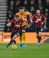 Bournemouth's Ryan Fraser (left) under pressure from  Wolverhampton Wanderers' Matt Doherty (centre)<br /> <br /> Photographer David Horton/CameraSport<br /> <br /> The Premier League - Bournemouth v Wolverhampton Wanderers - Saturday 23rd November 2019 - Vitality Stadium - Bournemouth<br /> <br /> World Copyright © 2019 CameraSport. All rights reserved. 43 Linden Ave. Countesthorpe. Leicester. England. LE8 5PG - Tel: +44 (0) 116 277 4147 - admin@camerasport.com - www.camerasport.com