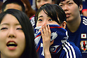 June 15, 2014, Tokyo, Japan - Japanese soccer fans are dejected as they watch Japan takes her first loss to Ivory Coast in a world cup soccer match in public viewing at Tokyos Marunouchi business district on Sunday, June 15, 2014. The west Africans beat Japan in a 2-1 come-from-behind victory in the preliminary round match of the 2014 FIFA World Cup in Recife, Brazil. (Photo by Natsuki Sakai/AFLO) AYF -mis-