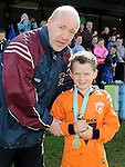 Ardee's Harry Butterly recieves Man of the Match trophy fromLiam Callan in their win over Slane Wanderers in the under 9 final at the Drogheda and District schoolboys cup finals in Hunky Dorys park. Photo: Colin Bell/pressphotos.ie