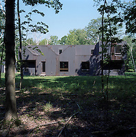 The corrugated copper sheeting covering the exterior of the house will darken and weather with time