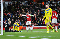 Theo Walcott of Arsenal (centre) celebrates after he scores his team's second goal of the game to make the score 2-0 during the UEFA Europa League match between Arsenal and FC BATE Borisov  at the Emirates Stadium, London, England on 7 December 2017. Photo by David Horn.