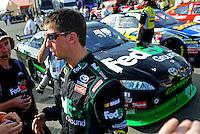 Oct. 9, 2009; Fontana, CA, USA; NASCAR Sprint Cup Series driver Denny Hamlin during qualifying for the Pepsi 500 at Auto Club Speedway. Mandatory Credit: Mark J. Rebilas-