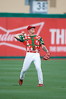 "Palm Beach Cardinals left fielder Shane Billings (22) throws the ball back into the infield during a game against the Charlotte Stone Crabs on July 22, 2017 at Roger Dean Stadium in Palm Beach, Florida.  The Cardinals wore special ""Ugly Sweater"" jerseys for Christmas in July.  Charlotte defeated Palm Beach 5-2.  (Mike Janes/Four Seam Images)"