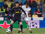 Heung-Min Son of Tottenham Hotspur FC (L) fights for the ball with Raphael Varane of Real Madrid (R) during the UEFA Champions League 2017-18 match between Real Madrid and Tottenham Hotspur FC at Estadio Santiago Bernabeu on 17 October 2017 in Madrid, Spain. Photo by Diego Gonzalez / Power Sport Images