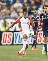 Toronto FC midfielder Reggie Lambe (19) attempts to control the ball. In a Major League Soccer (MLS) match, Toronto FC (white/red) defeated the New England Revolution (blue), 1-0, at Gillette Stadium on August 4, 2013.