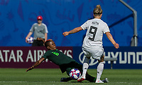 GRENOBLE, FRANCE - JUNE 22: Evelyn Nwabuoku #6 of the Nigerian National Team tackles Svenja Huth #9 of the German National Team during a game between Nigeria and Germany at Stade des Alpes on June 22, 2019 in Grenoble, France.