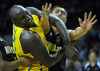 Nathan Jawai tangles with Reuben Te Rangi (right) during the FIBA Oceania men's tournament basketball match between New Zealand and Australia at TSB Bank Arena, Wellington, New Zealand on Tuesday, 18 August 2015. Photo: Dave Lintott / lintottphoto.co.nz