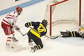 Matt Lane (BU - 21) scores. - The Boston University Terriers defeated the visiting Merrimack College Warriors 4-0 (EN) on Friday, January 29, 2016, at Agganis Arena in Boston, Massachusetts.