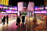 USA, Nevada, Las Vegas, tourists walk over the strip on a walking bridge near Planet Hollywood