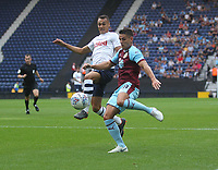 Burnley's Ashley Westwood gets a shot on goal under pressure from Preston North End's Graham Burke<br /> <br /> Photographer Mick Walker/CameraSport<br /> <br /> Football Pre-Season Friendly - Preston North End  v Burnley FC  - Monday 23st July 2018 - Deepdale  - Preston<br /> <br /> World Copyright &copy; 2018 CameraSport. All rights reserved. 43 Linden Ave. Countesthorpe. Leicester. England. LE8 5PG - Tel: +44 (0) 116 277 4147 - admin@camerasport.com - www.camerasport.com