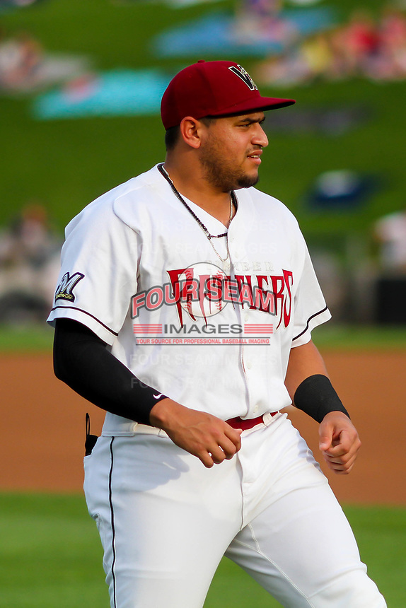 Wisconsin Timber Rattlers outfielder Jay Feliciano (37) warms up in the outfield prior to a Midwest League game against the Burlington Bees on August 3, 2018 at Fox Cities Stadium in Appleton, Wisconsin. Wisconsin defeated Burlington 5-4. (Brad Krause/Four Seam Images)