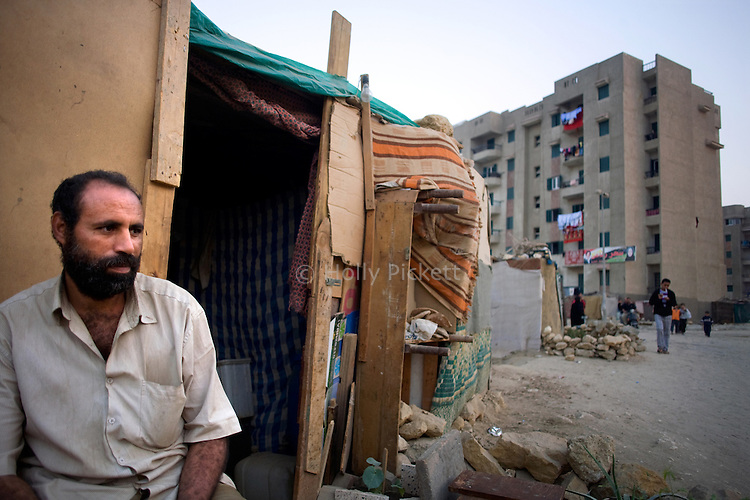 Said Ali sits in front of his shack in the Duweika area of Cairo, Egypt, Nov. 6, 2010. His home was demolished after a landslide killed scores of low-income Egyptians, but he has not been resettled by the government.