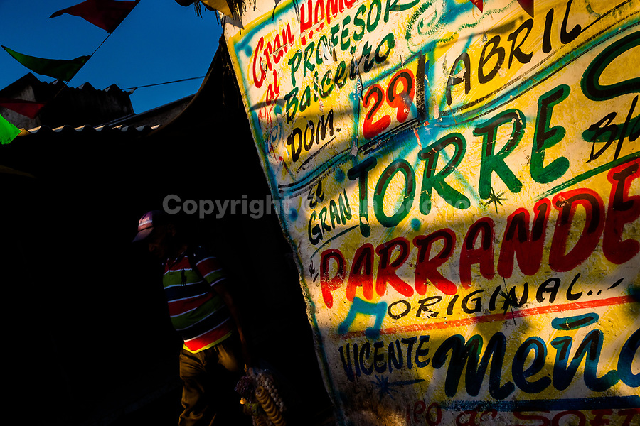 """A music party propaganda, created by Runner's collective, is seen painted on the wall in Bazurto market in Cartagena, Colombia, 5 December 2018. Hidden in the dark, narrow alleys of Bazurto market, a group of dozen young men gathered around José Corredor (""""Runner""""), the master painter, produce every day hundreds of hand-painted posters. Although the vast majority of the production is designed for a cheap visual promotion of popular Champeta music parties, held every weekend around the city, Runner and his apprentices also create other graphic design artworks, based on brush lettering technique. Using simple brushes and bright paints, the artisanal workshop keeps the traditional sign painting art alive."""
