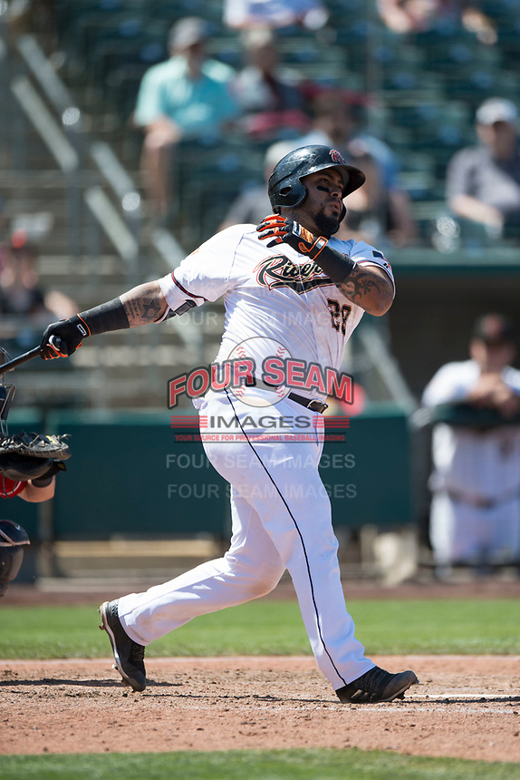 Sacramento RiverCats catcher Hector Sanchez (29) follows through on his swing during a Pacific Coast League against the Tacoma Rainiers at Raley Field on May 15, 2018 in Sacramento, California. Tacoma defeated Sacramento 8-5. (Zachary Lucy/Four Seam Images)