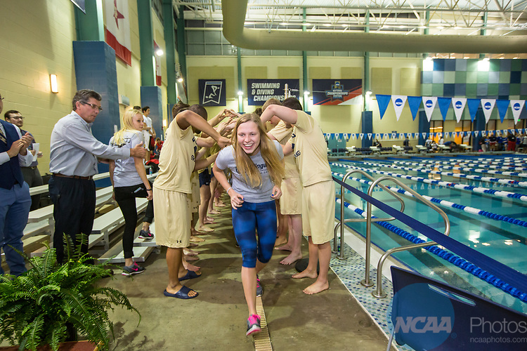 BIRMINGHAM, AL - MARCH 11: Third place women's team finishers Wingate University (346 points) are congratulated by first place men's team finishers Queens University (NC) (563.5 points) during the Division II Men's and Women's Swimming & Diving Championship held at the Birmingham CrossPlex on March 11, 2017 in Birmingham, Alabama. (Photo by Matt Marriott/NCAA Photos via Getty Images)