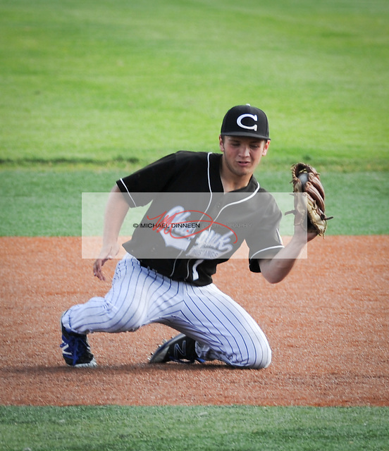 Chugiak shortstop Zachary Bohrer snags a bouncing grounder during their 15-5 win Sunday afternoon.  Photo for the Star by Michael Dinneen