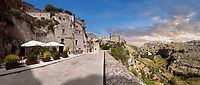 "Vew of ""la Gravina"" ravine and the Sassi of Matera, Basilicata, Italy. A UNESCO World Heritage site.<br /> <br /> The area of Matera has been occupied since the Palaeolithic (10th millennium BC) making it one of the oldest continually inhabited settlements in the world. <br /> <br /> The town of Matera was founded by the Roman Lucius Caecilius Metellus in 251 BC and remained a Roman town until  was conquered by the Lombards In AD 664 becoming part of the Duchy of Benevento.  Matera was subject to the power struggles of southern Italy coming under the rule of the Byzantine Roman, the Germans and finally Matera was ruled by the Normans from 1043 until the Aragonese took possession in the 15th century. <br /> <br /> At the ancient heart of Matera are cave dwellings known as Sassi. As the fortunes of Matera failed the sassy became slum dwelling and the appalling living conditions became be the disgrace of Italy. From the 1970's families were forcibly removed from the Sassi and rehoused in the new town of Matera. Today tourism has regenerated Matera and the sassi have been modernised and are lived in again making them probably the longest inhabited houses in the world dating back 9000 years."