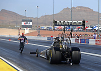 Apr 11, 2015; Las Vegas, NV, USA; A crew member guides NHRA top fuel driver Antron Brown back after his burnout during qualifying for the Summitracing.com Nationals at The Strip at Las Vegas Motor Speedway. Mandatory Credit: Mark J. Rebilas-