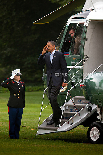 United States President Barack Obama salutes his Marine Guard as he returns to the White House after a two-day trip to the Gulf Coast, and shortly before giving his first national address from the Oval Office to confront the gulf oil crisis, in Washington DC, USA, on Tuesday, June 15, 2010..Credit: Jim Lo Scalzo - Pool via CNP