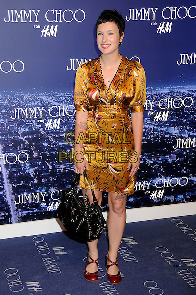 DIABLO CODY.Jimmy Choo for H&M Launch Party held at a Private Residence, West Hollywood, California, USA..November 2nd, 2009.full length dress yellow print gold red shoes black bag mary janes silk satin .CAP/ADM/BP.©Byron Purvis/AdMedia/Capital Pictures.