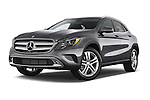 Stock pictures of low aggressive front three quarter view of2015 Mercedes Benz GLA 250 4Matic Exclusiefpakket 5 Door SUV Low Aggressive