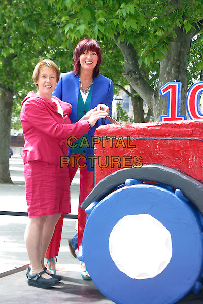 CAROLINE SPELMAN (Environment Secretary) & JANET STREET PORTER.Celebrating Red Tractor Week and the 10th anniversary of Britain's leading food assurance scheme. .June 15th, 2010.full length red blue trousers shorts skirt jacket .CAP/JEZ  .©Jez/Capital Pictures.