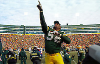 "Green Bay Packers defensive end Reggie White, known as ""The Minister of Defense"", points Heavenward as the Packers win the NFC Championship against the Carolina Panthers 30-13 on January 12, 1997 and thus return to the Super Bowl for the first time in 29 years. This was the first title game in Green Bay since the ""Ice Bowl"" in 1967."