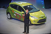 Alan Mulally, CEO of Ford, delivers a presentation in front of the Ford Fiesta during the Ford presentation at the Detroit Auto Show in Detroit, Michigan on January 11, 2009.