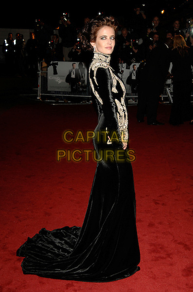 "EVA GREEN.""Casino Royale"" World Royal Film Premiere.Odeon cinema, Leicester Sqaure, London, England,.14th November 2006..james bond 007 full length black long velvet dress long sleeved cream patterned waistcoat looking back over shoulder.Ref: PL.www.capitalpictures.com.sales@capitalpictures.com.©Phil Loftus/Capital Pictures"